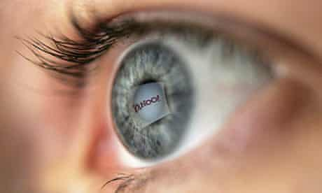 Yahoo logo reflected in the pupil of an eye framed by eyelashes