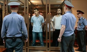 Defendants and guards look on during the 'Bolotnaya Square' trial