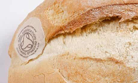 Loaf of white bread with Soil Association logo baked on