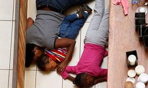 Faith Wambua and her children hiding from gunmen