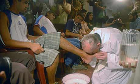 the pope kissing the foot of a detainee