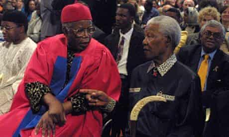 Acclaimed Nigerian author Chinua Achebe (L) and fo