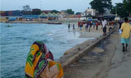 Women watch beach football in Stonetown, Zanzibar