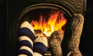 Couple Warming Feet in Front of Wood-Burning Stove