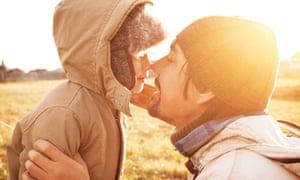 man and boy enjoying eskimo kiss