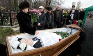 Widow grieves over her husband Sergei Magnitsky's body
