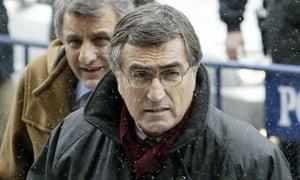 Turkish journalist Hasan Cemal (front) o