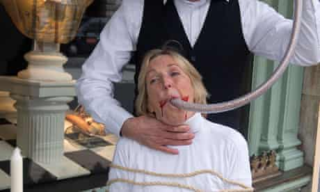 Ingrid Newkirk with a funnel of feed