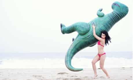 Crystal Renn dinosaur on beach Hunger magazine