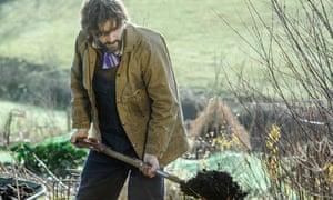 gardens - dan digging in mulch