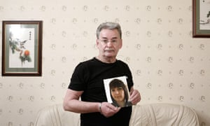 Michael Brown with a picture of his daughter Clare