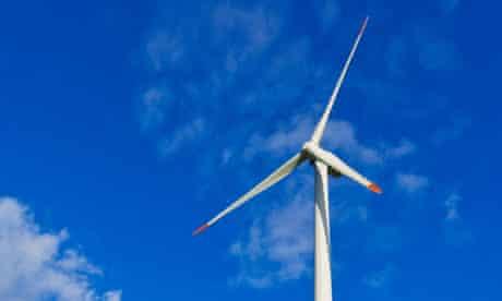 Wind turbine on a wind farm on a hilltop