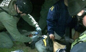 Dzhokhar Tsarnaev being searched by law enforcement officers