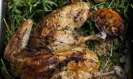 Spatchcocked chicken with rocket couscous in a pan