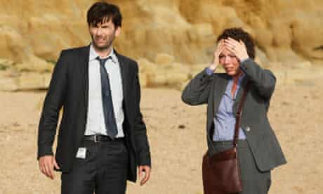 Olivia Colman with David Tennant on a beach in Broadchurch