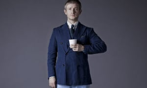 Martin Freeman standing proudly on an old TV set