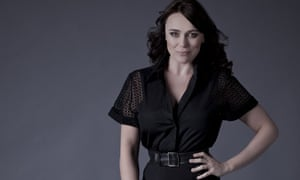 Keeley Hawes resting one knee on a TV set