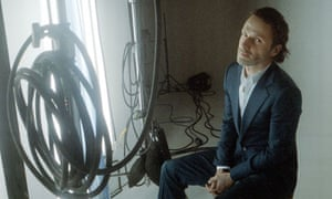 Andrew Lincoln sitting in front of coiled TV cables
