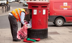 A postman emptying mail from a mailbox