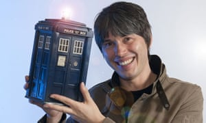 Professor Brian Cox holds a model of Doctor Who's Tardis