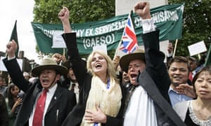Joanna Lumley celebrates with retired Gurkha soldiers outside Parliament in 2009