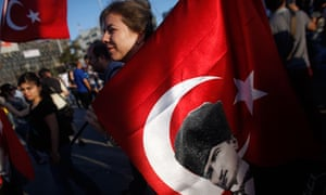 Turkey protester carries flag with Ataturk picture