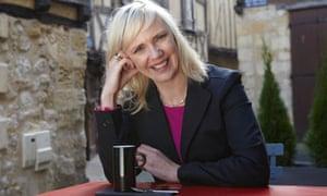 Samantha Brick at a table, smiling, in Bergerac, France