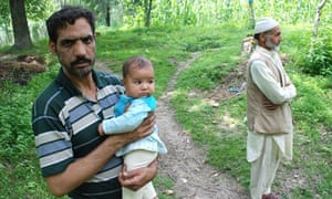 Shabir Ahmed Dar with one of his children