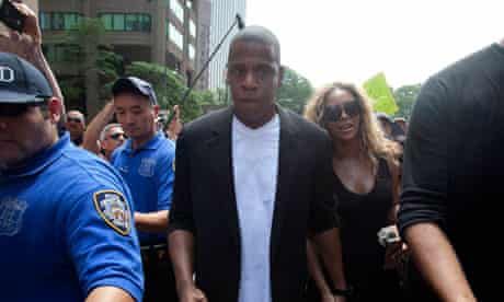 Singer Beyonce and her husband depart from a rally for Trayvon Martin in New York