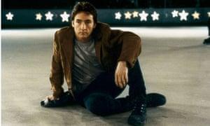 John Cusack sitting casually, cross-legged on the ground