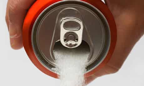 A can of sugar being poured into a glass