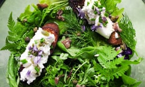 Nigel Slater's green leaves with goat's curd toasts on a plate