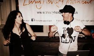 DJ Ilona Rampling dancing and looking at her husband Danny