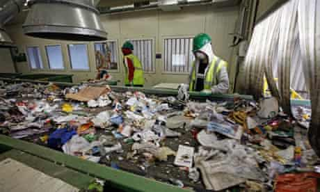 Workers sort recycling at Greenstar Recycling
