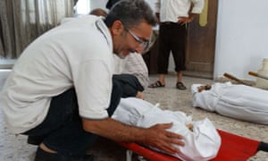 A Syrian man weeps over the body of a relative killed in what rebels say was a regime gas attack.