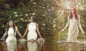 Sugababes wading through waist-deep water