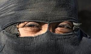 An Iraqi bedouin veiled woman is seen in