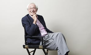 Barry Norman smiling, chin resting on his hand