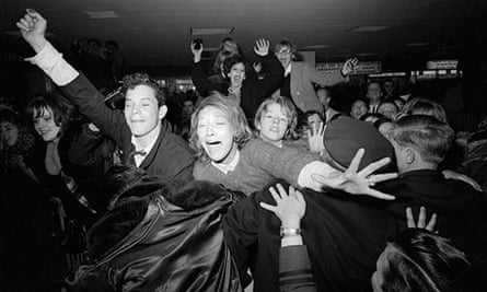 Beatles' fans are restrained by police at Kennedy Airport.