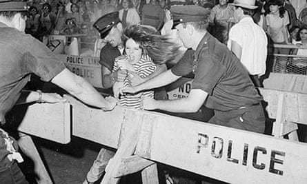 A young Beatles' fan tries to break through a police line at