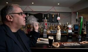 Kevin McKenna smokes electronic cigarette
