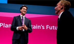 Ed Miliband welcomes Jim Murphy to the stage at Labour's 2014 conference in Manchester.