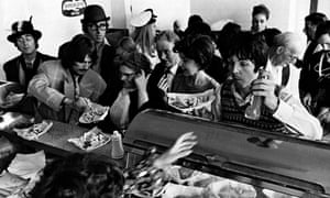 The Beatles at the counter of crowded fish and chip shop, Taunton, Somerset 1967