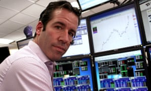 'Trillions and quadrillions': a trader 'pilots' the all-important computer screens in New York.