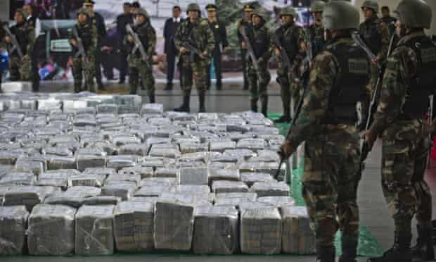 Police guard seized cocaine at Lima airport in Peru last September.