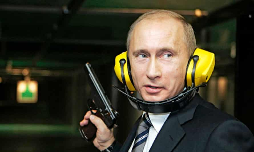 Hear no evil:  Russian president Vladimir Putin tries his hand at a Moscow shooting gallery.
