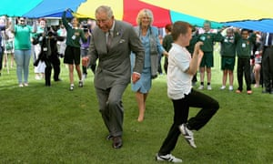 Charles and Camilla cut a caper during a 'parachute game' on a 2012 visit to Guernsey.