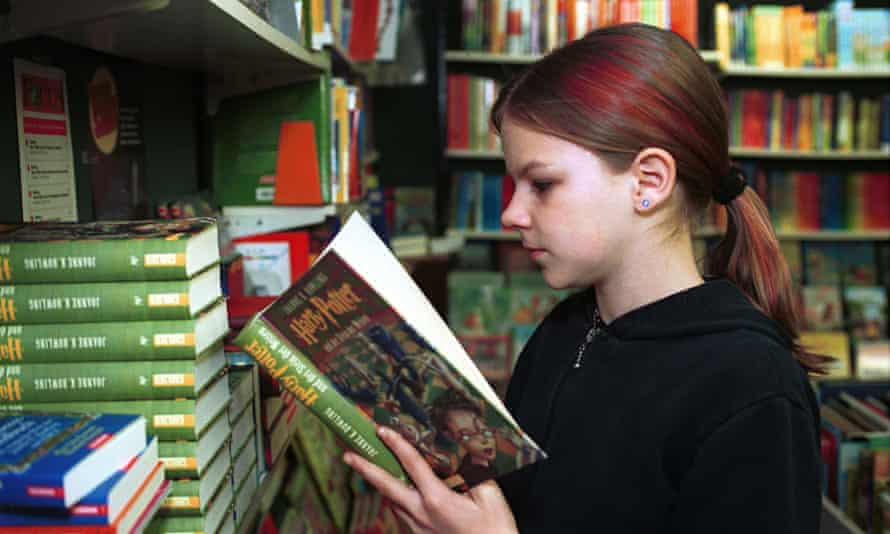 Reading girl in a bookstore