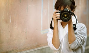 Photographer with a professional SLR camera