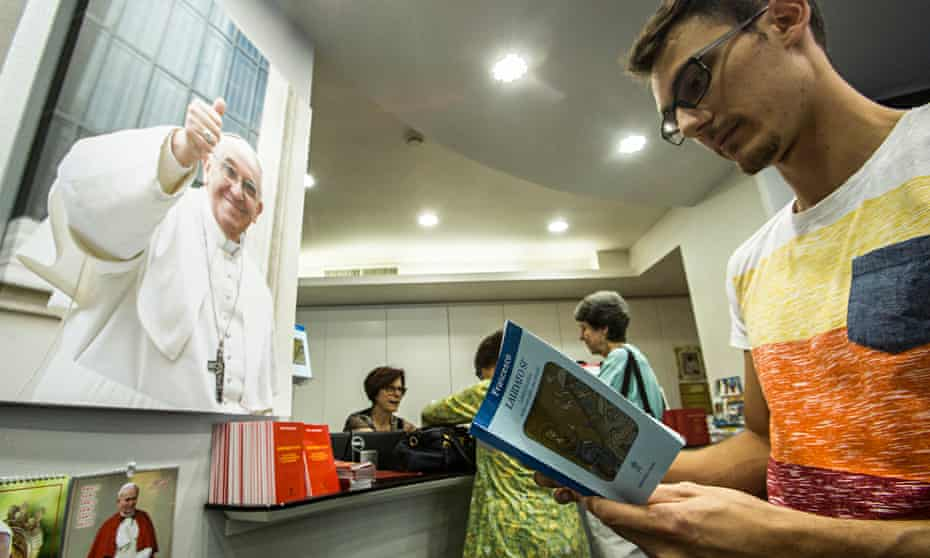 The faithful buy copies of Pope Francis's encyclical on the environment in Rome last week.